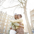 Young black couple hugging in a park at sunset, while visiting London city. — Stock Photo #20082371