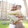 Young black couple hugging in a park at sunset, while visiting London city. — Stock Photo #20082377