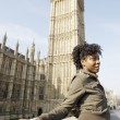 Young tourist standing by Big Ben in London city. — Stok fotoğraf