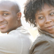 Young african american couple sitting back to back while visiting London on vacation — Stock Photo