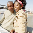 Black couple looking at a guide map on vacation — Stock Photo