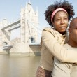 African american tourist couple visiting the Tower of London — Stock Photo #20082893