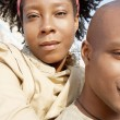 Stock Photo: Attractive african american couple with their heads together standing by the Tower of London