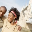 Young attractive black couple visiting the Tower of London - Stock Photo