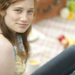 Teenage girl sitting down with picnic in a forest. — Stock Photo #20083073