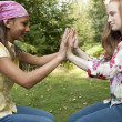 Stock Photo: Teenage girls playing in the forest.