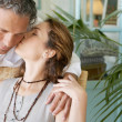 Stylish mature couple kissing at home. — Foto Stock