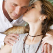 Stock Photo: Close up of mature couple kissing.