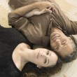Over head portrait of a mature man and woman laying down on carpet — Stock Photo
