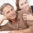Mature couple lounging on white sofat home. — Stock Photo #20083867