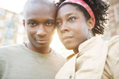 Portrait of a young black couple of tourists visiting the city at sunset — Stock Photo