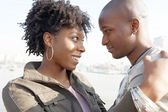 Close up portrait of a young black tourist couple visiting London city — Stock Photo