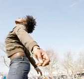 Attractive black woman expressing freedom against an intense blue sky — Stock Photo
