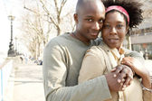 Attractive african american couple visiting London and hugging — Stock Photo