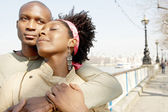 African american couple visiting London city and hugging — Stock Photo