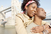African american tourist couple visiting the Tower of London — Stock Photo