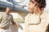 Portrait of an african american man and woman standing by Tower Bridge — Foto Stock