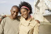 Young african american couple at London's Tower Bridge — Stock Photo
