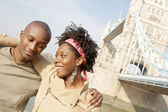 Young attractive black couple visiting the Tower of London — Stock Photo