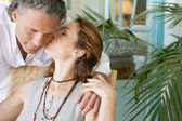 Stylish mature couple kissing at home. — Stock Photo