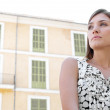 Panoramic view of an ttractive businesswoman against classic buildings. — Stock Photo