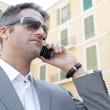 Businessman having a phone conversation using his smart phone — Stock Photo #20201339