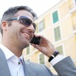 Businessman having a phone conversation using his smart phone — Stock Photo #20201357