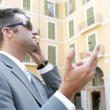Businessman using a smart phone to have a conversation — Foto de Stock