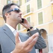 Businessman using a smart phone to have a conversation — Stock Photo