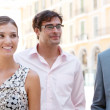 Three business standing together next to a classic office building in the city on a sunny day — Stock Photo