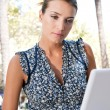 Young businesswoman using a laptop computer — Stock Photo #20202251