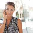 Portrait of a young attractive businesswoman using her smart phone to make a call — Stock Photo #20202669