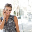 Young attractive businesswoman using her smart phone to make a call — Stock Photo #20202675