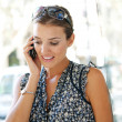 Portrait of an attractive businesswoman having a conversation on her smart phone - Foto Stock