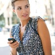 Young businesswoman using a smart phone — Stock Photo #20202703