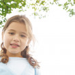 Portrait of a young girl in the park smiling at the camera. — Stock Photo