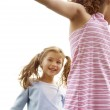Two young girls playing outdoors on a sunny day, smiling. — Stock Photo