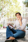 Businessman using a hands free device to make a call on his cell phone — Stock Photo