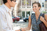 Businessman and businesswoman shaking hands in business agreement — Stock Photo