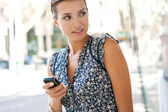 Young businesswoman using a smart phone — Stock Photo