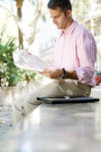 Senior businessman reading a newspaper — Stock Photo
