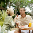 Young attractive couple having breakfast — Stock Photo