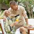 Young couple laughing while having a luxury breakfast — Stock Photo #21100333