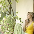 Attractive blonde woman using a cell phone outdoors — Foto Stock