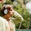 Young attractive man listening to music with headphones — Foto de stock #21100585