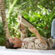 Attractive young man reading a book — Stok fotoğraf
