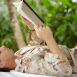 Attractive young man reading a book — Stock Photo #21100951