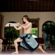 Attractive man practicing his martial arts techniques while on vacation — ストック写真