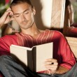 Attractive man reading a book — Stock Photo #21101955