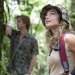 Stock Photo: Man and woman in a forest expedition.